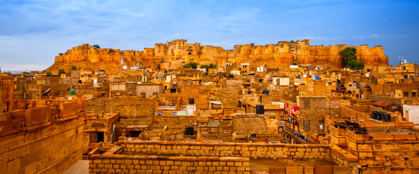 The Jaisalmer Fort rising over the sand-colored buildings of Jaisalmer city proper.