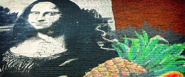 The famous mural of the Mona Lisa with fruit in Kensington Market. Photo credit Shreyans Bhansali CC BY-SA.