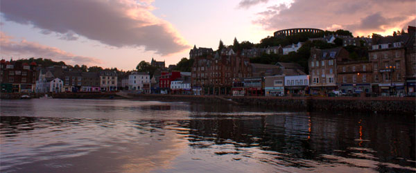 A colorful sunrise over the harbor of Oban.