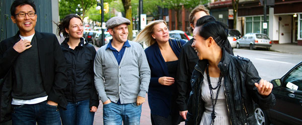 A group enjoying their day out on the Gastown Tasting Tour by Vancouver Food Tour.