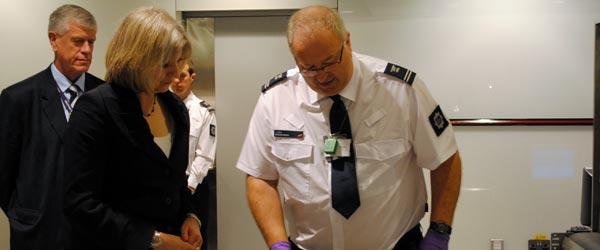 Home Secretary Theresa May visiting with UK Border Agency officers at Heathrow.