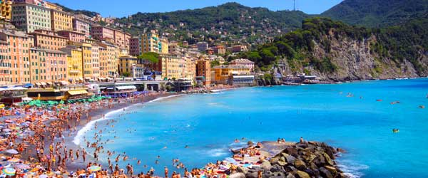 The Camogli town beach packed with sun worshippers.