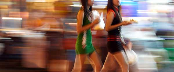 A few bar girls walking through Patpong.