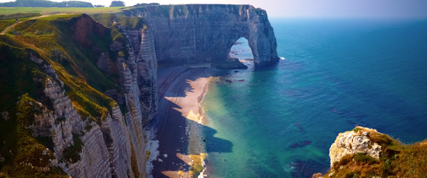 The stunning chalk cliffs on the coast at Étretat Plage. Photo by Moyan Brenn via Flickr.