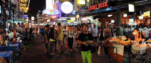 Tourists amongst the bars and street food stalls of Khao San Road.