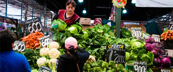 Customers buying produce from Santiago's Mercado Central. Photo by Mitch Altman via Flickr.