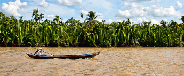 A boat plying the Mekong River near Saigon. Photo credit LisArt.