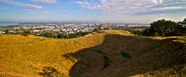The volcanic crater of Mount Eden with its view of Auckland. Photo credit macronix.