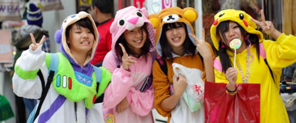 Teenage girls dress up in elaborate costumes and show off in Harajuku.