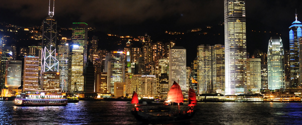 A junk sailing on the Hong Kong Harbor past Central.