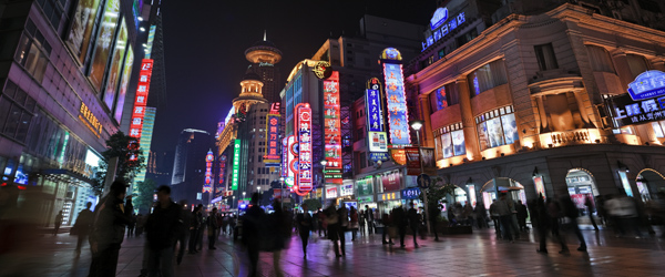 The bright lights of the bustling Nanjing East Road pedestrian mall.