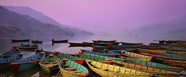 Boats on the lake at Pokhara during dusk.