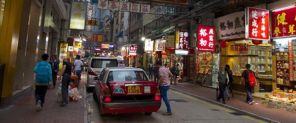 Taxis on a crowded street in Sheung Wan. Photo by Bevis Chin/Flickr.