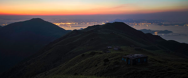 Sunrise as seen from Sunset Peak in Lantau. Photo by leo.wan/Flickr.